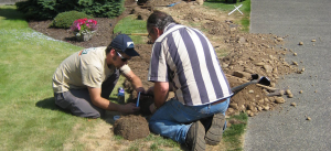 two Alexandria irrigation repair specialists replace a cracked PVC pipe
